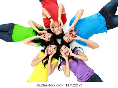 happy group of friends screaming with their heads together on the floor