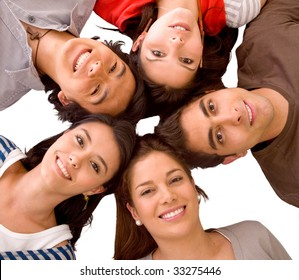 happy group of friends with their heads together on the floor isolated