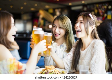 happy Group of girl friends toasting and eating in the  restaurant
