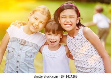 Happy group of girls in kindergarden in summer