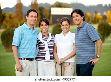 Happy group of golf players outdoors and smiling