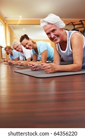 Happy group in a gym doing Pilates
