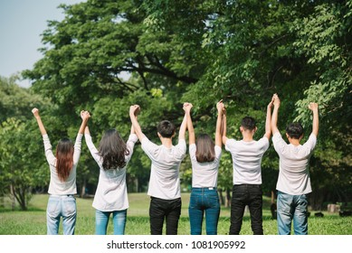 happy group initiative volunteer people cheerful together - Empower Teamwork Charity Volunteer Promise Protect forest and save world