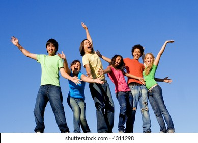 happy group of mixed race teens