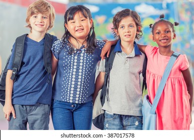 Happy group of multi ethnic children together at school.