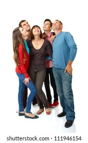 Happy group of people happy looking up, full length. over white background