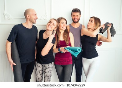 happy group of people from men and women practicing yoga in fun