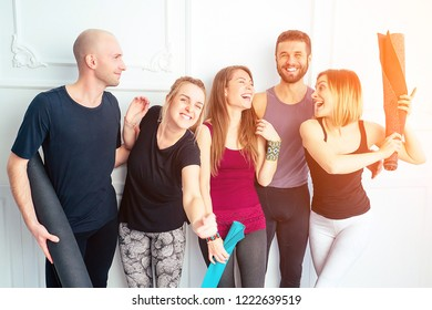 happy group of people from men and women practicing yoga in fun in the studio. groups of meditation and support in the yoga class. yoga, mate, man, woman, many people