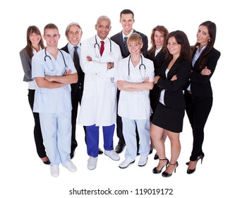 A happy group photo depicting a group of staff people. Isolated on white