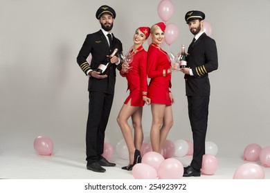 Happy group of pilots and stewardesses