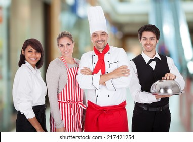 Happy Group Of Restaurant Staff Smiling Indoor
