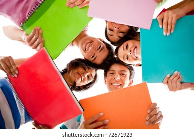 Happy group of students holding notebooks - isolated over white