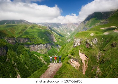 Happy group of tourists enjoying view mountains during summer vacation in Georgia(country).