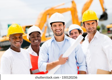 Happy group of working men at a construction site