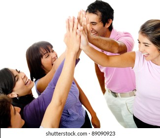 Happy group of young friends giving a high-five isolated over a white background
