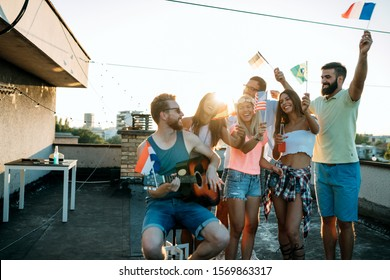 Happy group of young friends having fun in summer