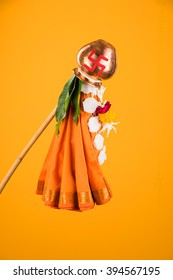 Happy Gudi Padwa greeting - it's a Hindu New Year celebrated across India where Gudhi is errected outside home made up of Bamboo stick, cloth, garland, neem and Mango leaves with Kalash