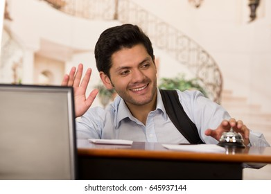 Happy guest touching the bell of the recepcionist
