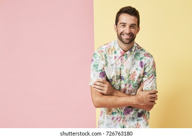 Happy guy in floral shirt smiling to camera