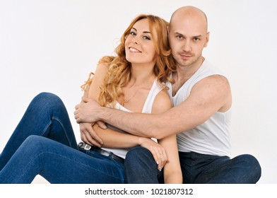 Happy guy and girl. Girl is hugging the boy. Beautiful happy couple. Love story. Family photo.