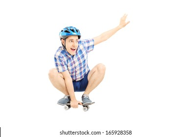Happy guy with helmet skating on a skate board isolated against white background