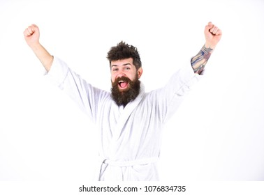 Happy guy shouting: Hurray! Energetic bearded man isolated on white background. Hipster with tattoo on arm standing in room. Perfect morning concept.