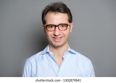 Happy guy in spectacles studio portrait