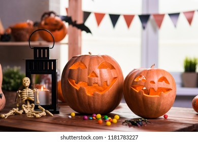 Happy Halloween. Background in front of a window with pumpkins, lantern, spiders and other symbols of a terrible holiday