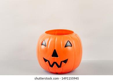 Happy Halloween Day, Spooky day. Pumpkin trick or treat basket, orange pumpkins, scary metal house