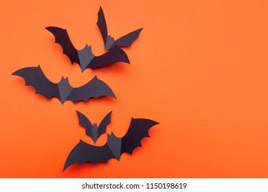 Happy Halloween. Festive background. Lots of bats on bright orange background