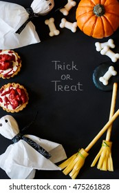 Happy Halloween frame with candy and cookies.