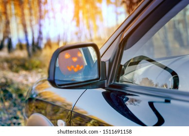 Happy Halloween! Jack o'lantern driving a car. Tradition concept.