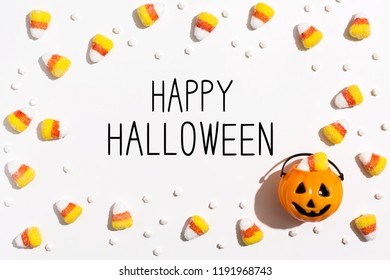 Happy Halloween message with pumpkin overhead view on a solid color