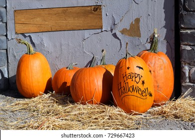 Happy Halloween pumpkin with blank wooden sign. Add your own text.