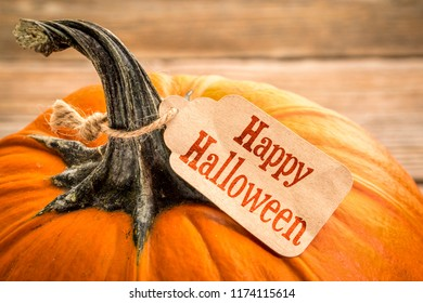 Happy Halloween - a pumpkin with a paper price tag