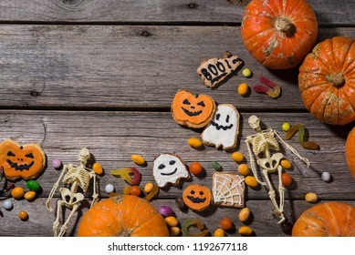happy halloween pumpkins, spiders, horror stories and more on a wooden background