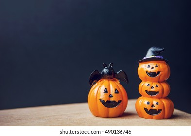 Happy Halloween, Two Pumpkin on table wood with dark wall background, halloween concept. Copy space.