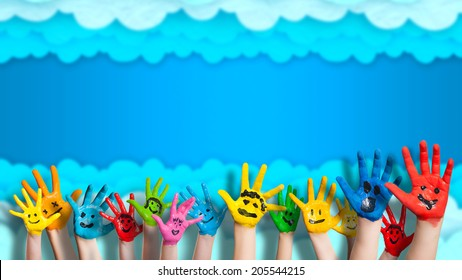happy hands in front of a cloudy wall