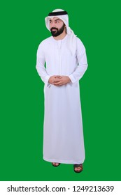 A Happy Handsome Arab Man Proudly Smiling And Welcoming Wearing UAE Tradational Kandora  ( UAE DRESS WELCOME )