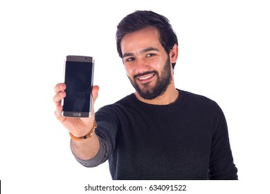 Happy handsome beard young man smiling and holding a smart phone, guy wearing gray t-shirt, isolated on white background