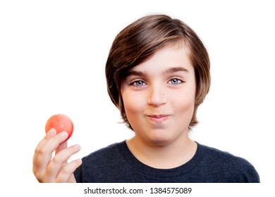 Happy handsome boy with the macaron on white background