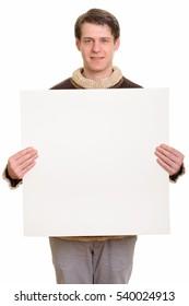 Happy handsome Caucasian man holding copyspace