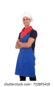 Happy handsome chef smiling and standing confidently, guy wearing a blue chef uniform and chef hat, isolated on white background