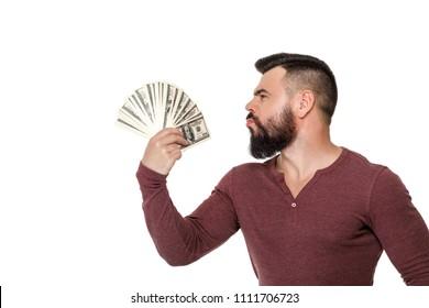 happy handsome man with beard holding money dollar bills