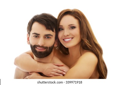 Happy handsome man carrying girlfriend on his back.