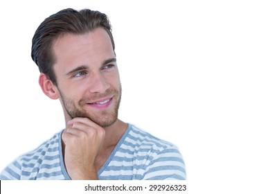 Happy handsome man looking away on white background