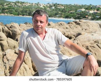happy handsome man on sea beach summer