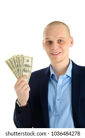 Happy handsome man in a suit holding fan of dollar banknotes, businessman and money. Isolated on white background.