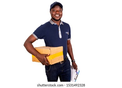 happy handsome young delivery man in blue uniform holding a press paper with empty paper document, and holding a cardboard looking at the camera