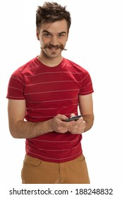 Happy, handsome young man smiles and plays with his mobile phone, isolated on white background